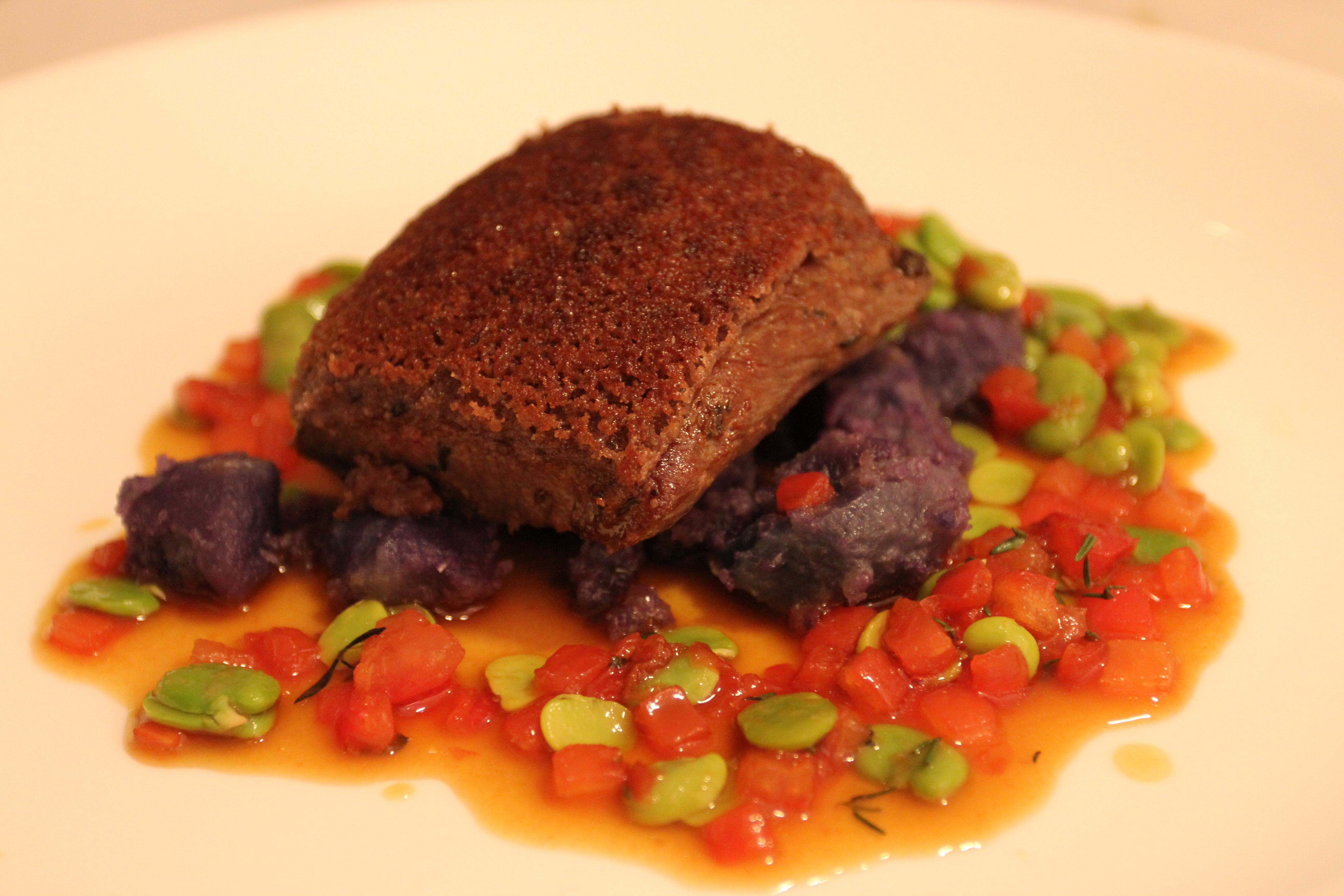 Sungold Lamb, Olive Crust, Tomato-Thyme and Fava Jus